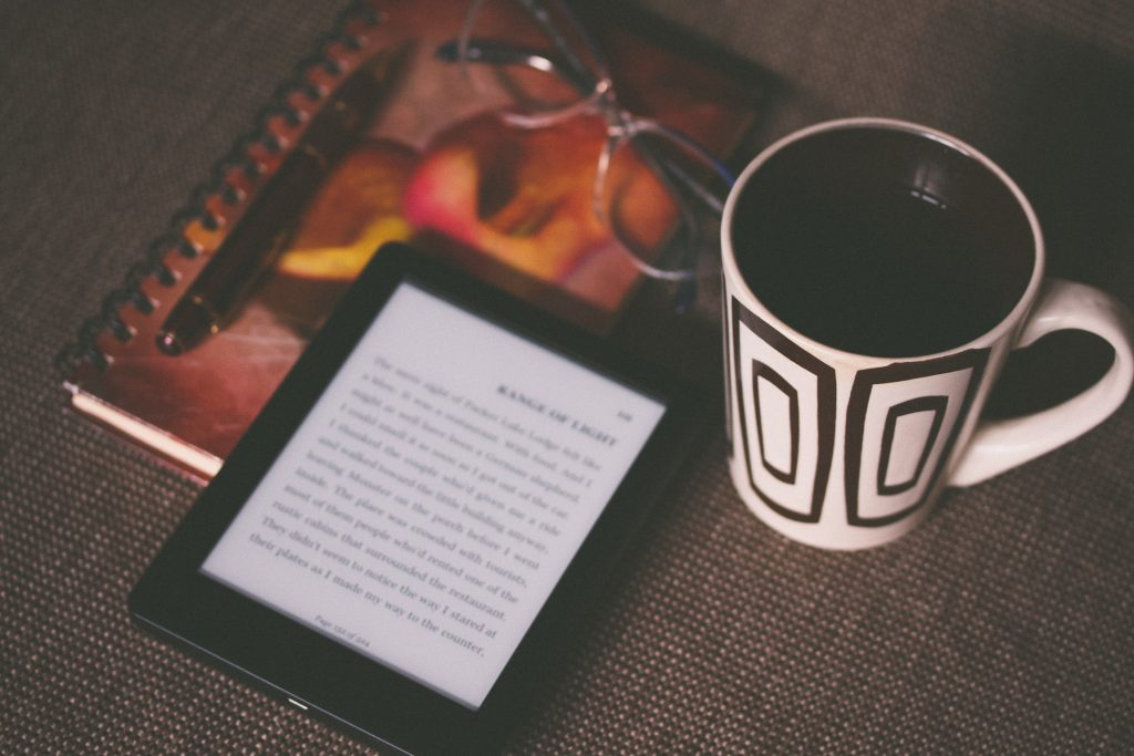 ebook reader and coffee cup
